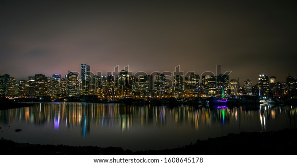 Night image of Downtown Vancouver British Columbia Canada from Stanley Park.