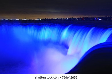 Night image of the illuminated Niagara Falls in Canada.  One of the 7 wonders of the world.