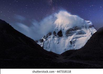 Night Kailash cloud flags on top and tracks of stars for long exposure.