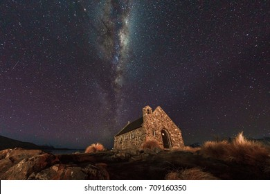 Night in Lake Tekapo with a Church of the Good Shepherd and milkyway in background