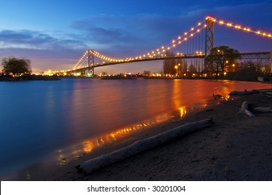 Night landscape. Ambassador Bridge linking Detroit, USA and Windsor ON, Canada. The second bridge, significantly larger is under construction.