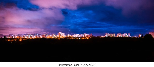 Night landscape with buildings in the background, purple sky with clouds, Itapema - Santa Catarina - Brazil