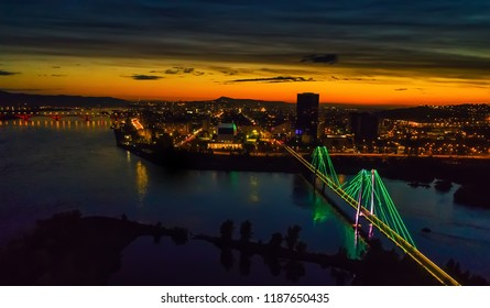 Night landscape, the city of Krasnoyarsk in Russia, Siberia, on the Yenisei River, aerial photography, soft focus, noise