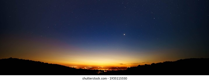 Night landscape with light from the city on the horizon