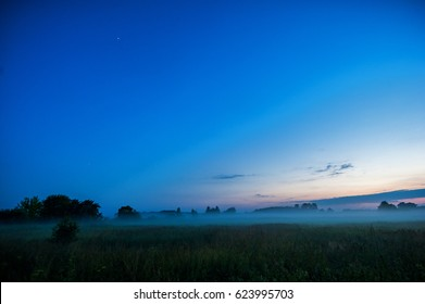 Night Landscape with Mist and Clear Blue Sky