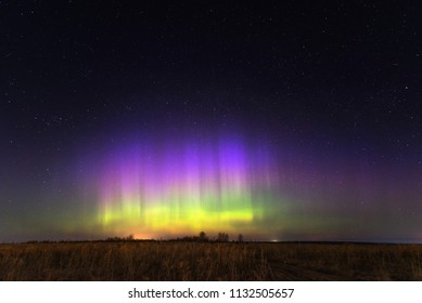 Night landscape with northern lights. Aurora borealis.