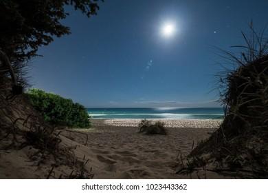 Night landscape on Puglia coast line with milky sea wave