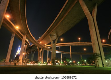 Night landscape: park under Bhumibol, Industrial ring, bridge in Bangkok, Thailand