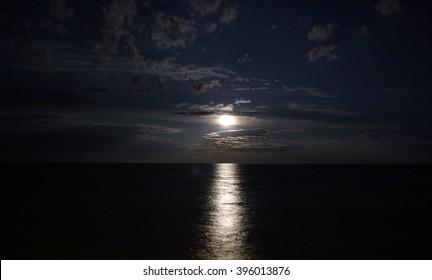 Night landscape of the sea, moonlit path