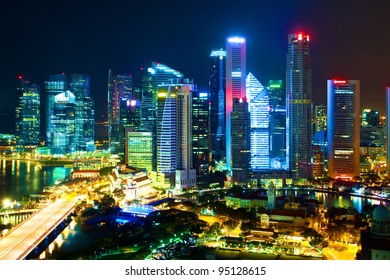 Night landscape of Singapore's downtown high-rise buildings and neighborhoods in colored night light