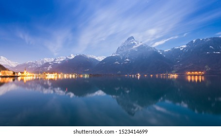 Night landscape. A small town in the Swiss Alps. Stars in the night sky.
