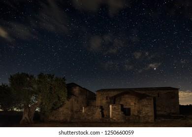 Night landscape with the Visigothic Basilica of Santa Lucia del Trampal. Acuescar. Spain.