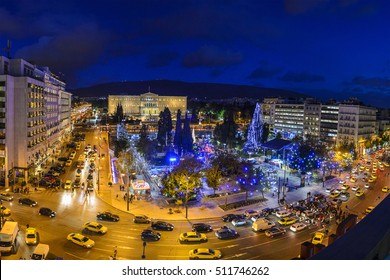 Night life at Syntagma Square (Constitution Square) which is decorated for Christmas. Panoramic aerial view in Athens City. Athens - Greece.