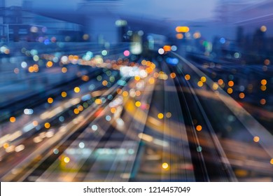 Night light bokeh city downtown over train track motion, abstract background