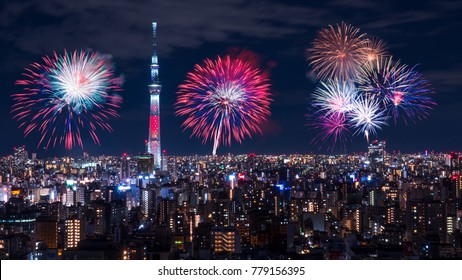 Night light cityscape view with fireworks over modern building in Tokyo, Japan (Public scene from the window in the hotel)