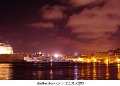 Night lights of Birgu Vittoriosa and the Grand Harbor of Valletta, Malta