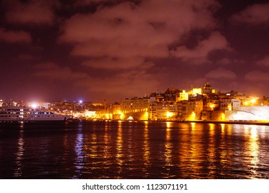 Night lights of Birgu Vittoriosa and the Grand Harbor of Valletta, Malta