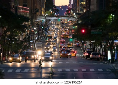 Night lights of crosstown traffic on 42nd Street through Midtown Manhattan in New York City NYC