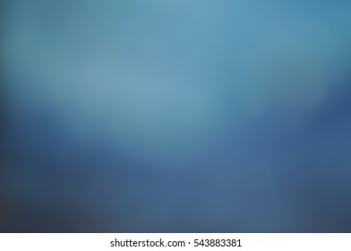 Night lights illuminated the city blurred bokeh bright colorful dark dirty grunge background Wallpaper hat web site lights and headlights do not focus on the street brown blue soft gradient
