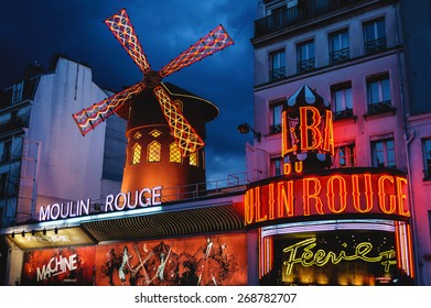 Night lights of the Moulin Rouge cabaret in Paris, France on August 6, 2012