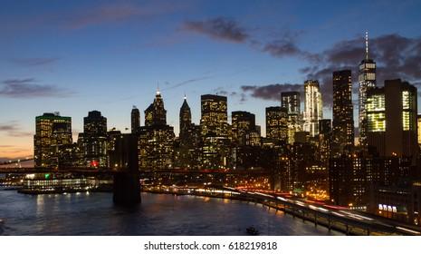 Night lights of the New York City skyline at dusk in Manhattan, NYC