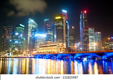 Night lights of Singapore with reflection in the river
