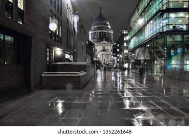 Night London street in black and white. Rainy typical weather in London street in night.