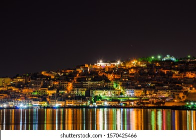 Night long exposure scenery of Mikrolimano in Athens city, Greece. View from the seafront of Flisvos marina at Faliro, Athens, Greece