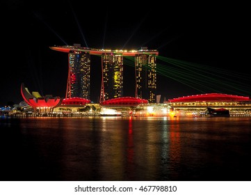 Night of the Marina Bay. Singapore - June 05, 2016 Illuminated at night, office buildings and Lookout Gardens by the Bay Marina on the Bay in Singapore