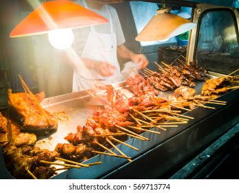 Night market selling pork in bangkok thailand