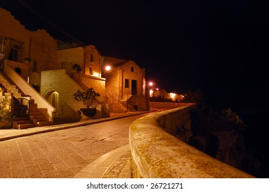 Night in Matera, Italy, on the Via Madonna Delle Virtu at the Edge of the Ravine