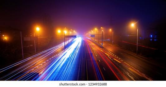 night misty road in sity almaty