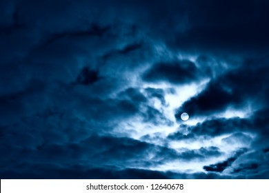 Night moon and clouds. Blue tint.