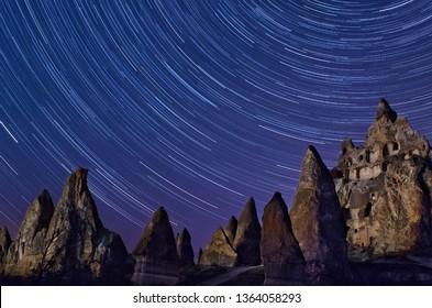 Night Mountain landscape with stars in Cappadocia, Turkey.