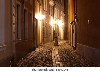 Night at narrow street in capital of Latvia - Riga