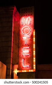 Night neon motel sign. American style motel outdoor advertisement sign. Love motel sign board.