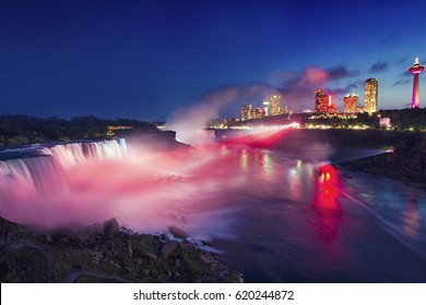 Night at Niagara Falls And American Falls with Colorful Lights, New York State, USA