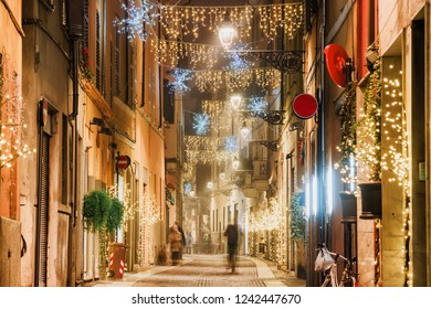 Night old street with Christmas decoration in Parma, Emilia-Romagna, Italy. Old Parma architecture and landmark