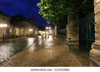 night old street with shining cobblestone after rain and buildings lined with stone limestone, ancient Bavarian town - Bayreuth, Upper Franconia, Bavaria, Europe, Germany, wallpaper art townscape