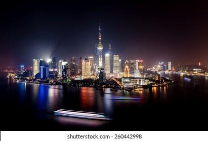 Night panorama of beautiful Shanghai city with bright lights, China