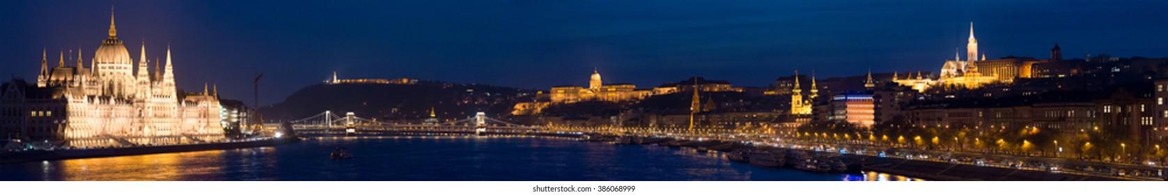 Night panorama of Budapest city. Parliament building on left, Buda castle hill on right and chain bridge in middle. Hungary, Europe travel.