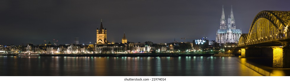 Night panorama of Cologne and river Rhine