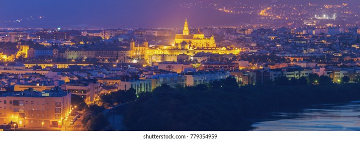 Night panorama of Cordoba with Mosque Cathedral. Cordoba, Andalusia, Spain.