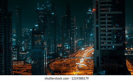 Night panorama of a large modern city, tall buildings and city highway. Skyscrapers Of Dubai