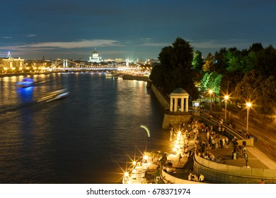 Night panorama of Moscow. Moscow river with night illumination. Night view of the Gorky Park, Krymsky Bridge, Christ the Savior Cathedral and the city center. Moscow, Russia. Night landscape of Moscow