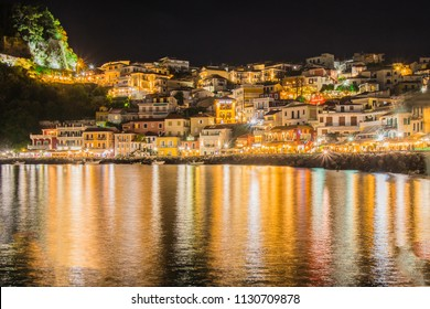 Night panorama or nightscape of the city of Parga, Greece. Looking across the bay towards traditional houses and syvota castle.