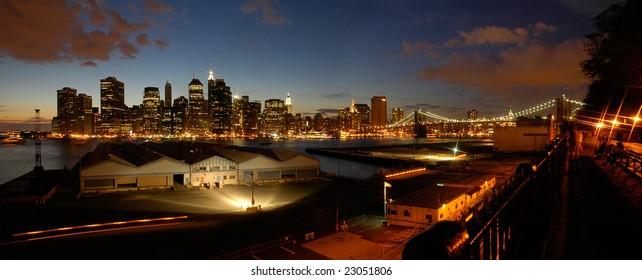 night panorama photo of lower manhattan, brooklyn bridge in picture