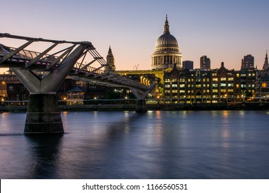 Night panorama of the river Thames with the London Millennium bridge and the dome of St Paul's Cathedral, London, United Kingdom. The St Paul's Cathedral is one of the main churches of the city