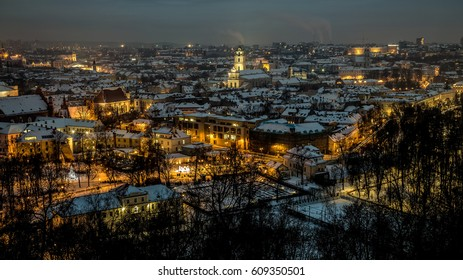 Night panorama of the Vilnius Old Town from the Hill of Three Crosses, Lithuania. Vilnius winter aerial panorama of Old town.
