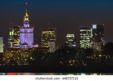Night panorama of Warsaw skyline over Vistula river, Poland
